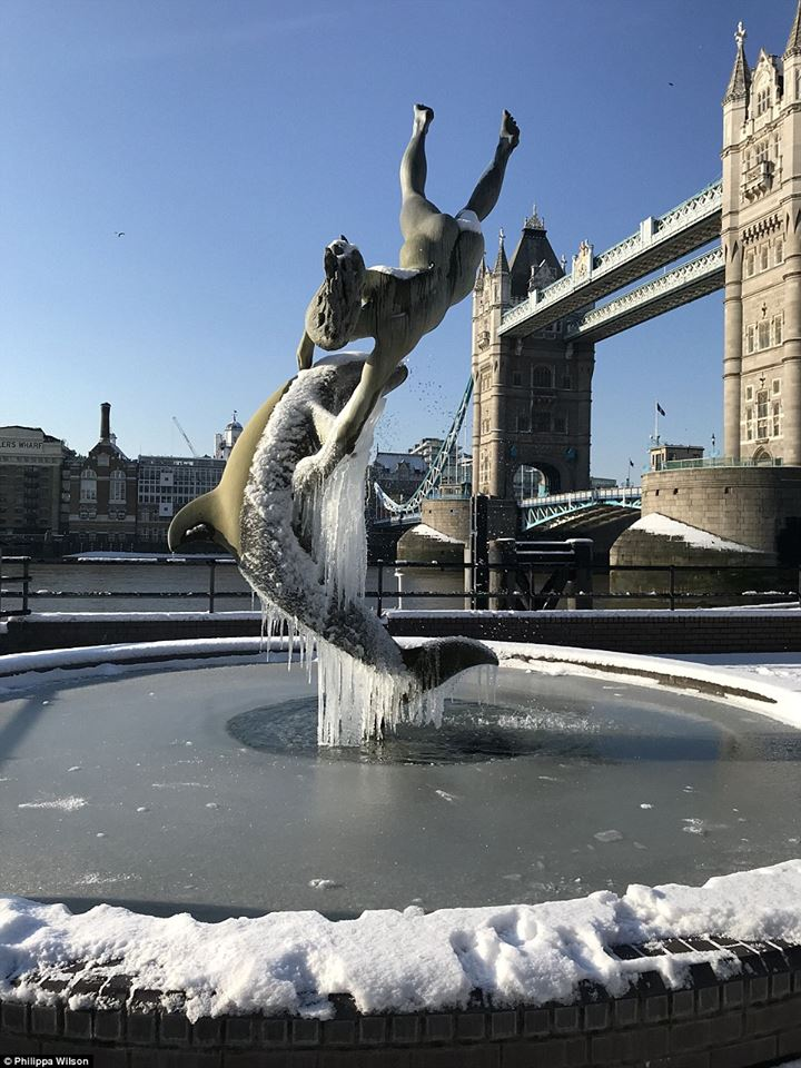 Dolphine and Child - frozen fountain near Tower Bridge, London - by Philippa Wilson